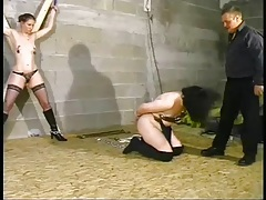 Two sub pain sluts in the dungeon made to lick tubes