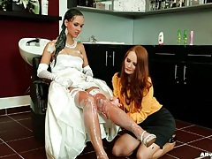 Bride in dress and gloves gets her hair washed tubes