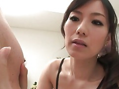 Japanese beauty licks his nips and sucks his dick tubes