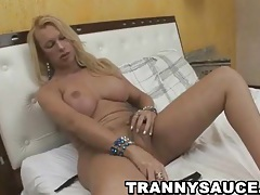 Yummy busty blonde shemale eagerly beating her meat tubes