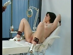 Speculum opens pussy of a bound girl tubes