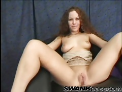 Curly hair girl gets on her knees and sucks dick tubes