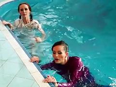 Girls dressed in satin take a swim for fun tubes