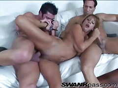 Two guys fuck a tanned milf in threesome tubes