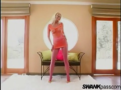 She rips her pink fishnets and models her body tubes