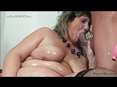 Fat chick coated in milk and oil gives him a titjob tubes