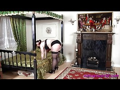 French maid strips and gets a caning from behind tubes