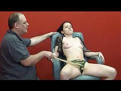 Her eyes are closed in pain during bdsm video tubes