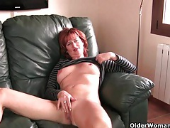 Redheaded mature mom plays with her nipples and pussy tube