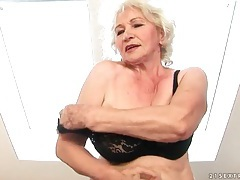 Granny strips from dress to rub her pussy tubes