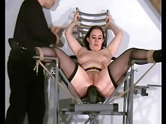Her body shakes from the ass spanking pain tubes