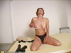 Cute milf masturbates pussy with big toy tubes