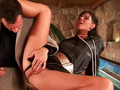 Beauty in shiny blouse bent over and fucked tubes