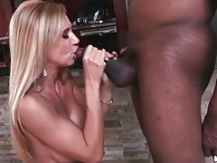 Milf with big boobs sucks a black cock tubes