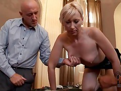 Guys pinch her nipples as she sucks dick tubes