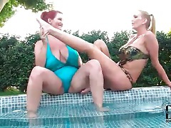 Curvy women in swimsuits suck on their toes tubes