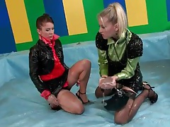 Women in leather skirts ready to oil wrestle tubes