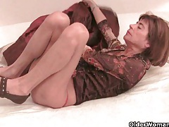 Very skinny granny stretching her tight pussy with a dildo tubes