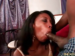 Black chick changes into slutty clothes and sucks cock tubes