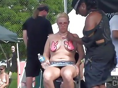 Girls get their tits painted at a party tubes