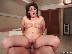 Curvy mature in glasses rides dick in bathroom tubes