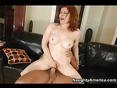 Redhead milf with fake tits and hairy cunt rides tubes