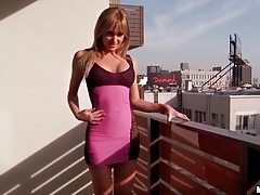 Girl with gorgeous body models skintight dress tubes