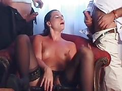Classy slut in stockings sucks on two dicks tubes