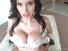 Her big tits are fondled before she blows tubes
