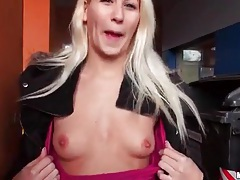 Young blonde shows her tits in parking lot tubes