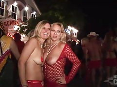 Scantily clad costume girls at street party tubes