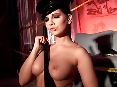 Police officer eve angel plays with night stick tubes