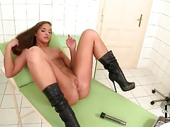Leather boots girl plays with pussy and ass tubes