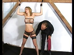 Flogging a fake tits girl in bondage tubes