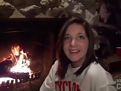 Teenager in front of fireplace has tight body tubes