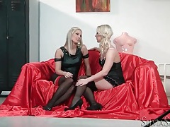 Blonde girls in sexy clothes kiss and touch lustily tubes