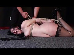 Girl on her stomach in sexy rope bondage tubes