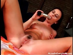 Stripping brunette bangs toy in her pussy tubes