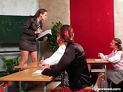Bossy teacher and satin clad schoolgirl in class tubes