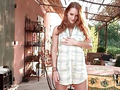 Cute redhead in a sexy solo tease outdoors tubes