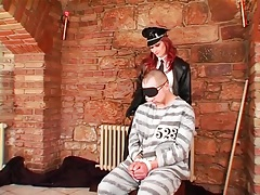 Dominant redhead abuses a male prisoner tubes