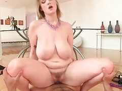 He bangs a slut and busts a nut on her big tits tubes