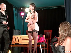 Girl on stage strips and is judged on her body tubes