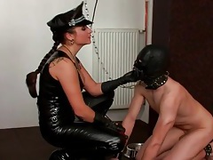 Masked and bound man submits to leather mistress tubes