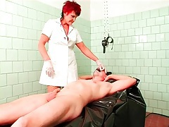 Mature nurse in gloves fingers his asshole tubes