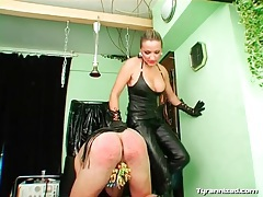 Leather mistress puts clamps on his cock and balls tubes