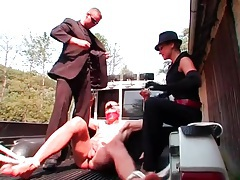 Guy bound in the back of a truck is abused tubes