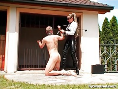 Collared man trampled by latex mistress tubes