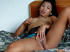 Asian whore masturbates in hotel room tubes