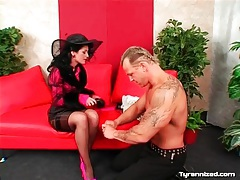 Muscular man submits to fully dressed mistress tubes